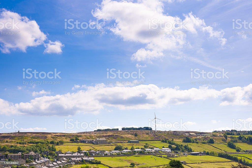 Wind Turbine near residential area royalty-free stock photo