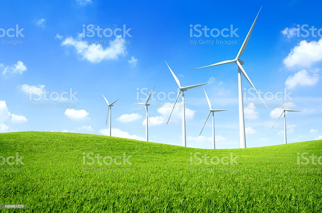 Wind turbine on a green field stock photo