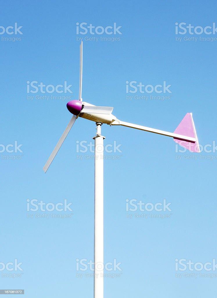 wind turbine on blue sky background royalty-free stock photo