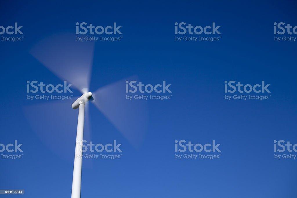 Wind Turbine on Blue Sky stock photo