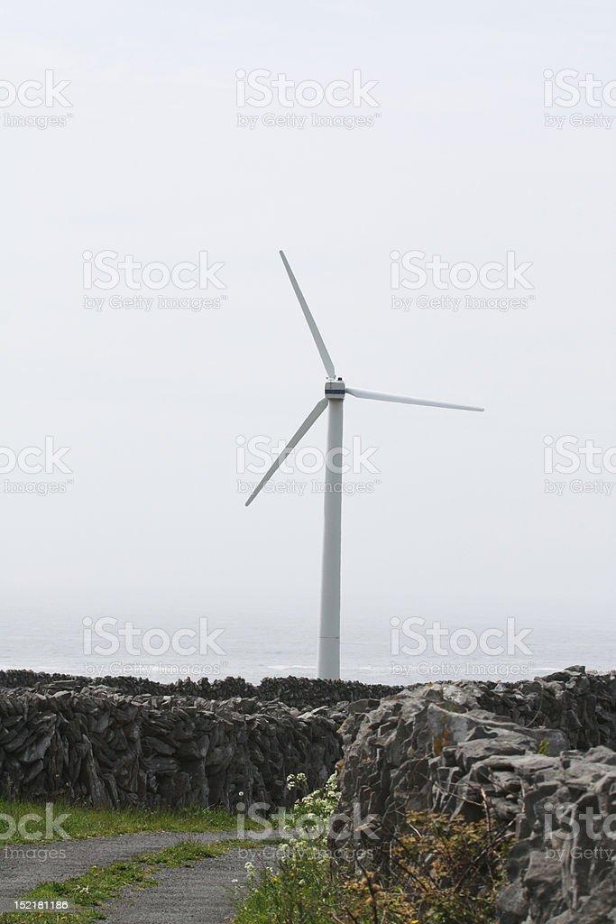 Wind Turbine on Country Lane stock photo