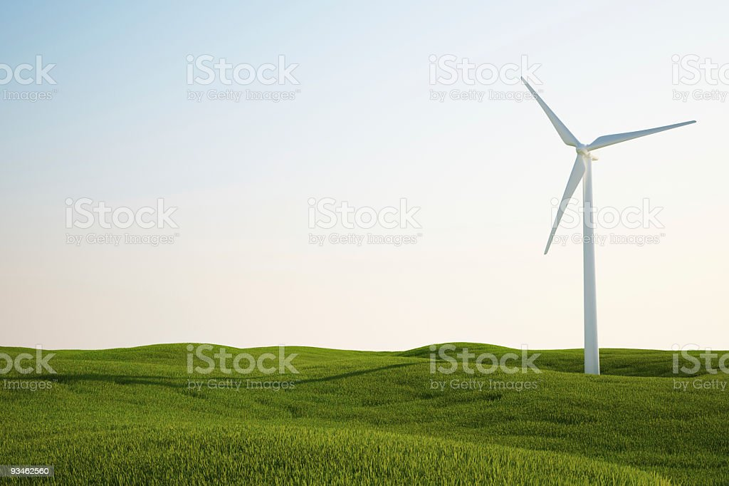 wind turbine on green grass field royalty-free stock photo