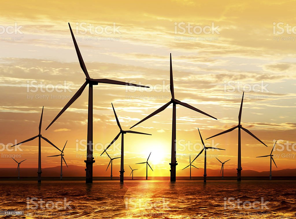wind turbine on sunset stock photo
