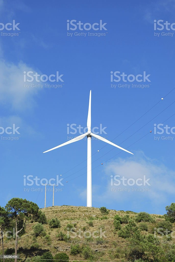 Wind turbine on the top of a mountain stock photo