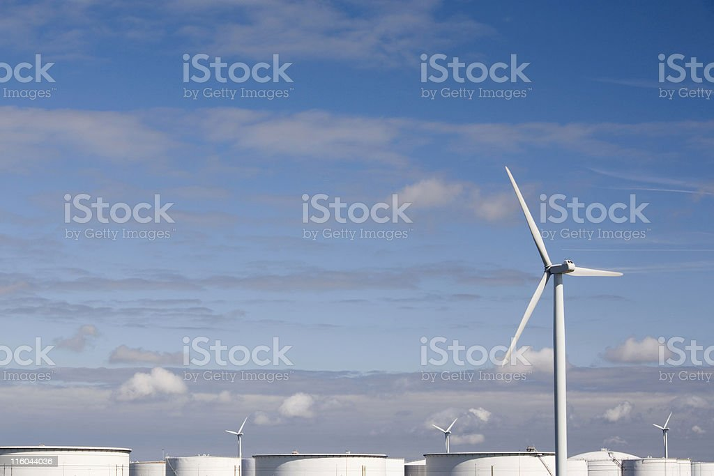 wind turbine power stations against a partly clouded blue sky royalty-free stock photo