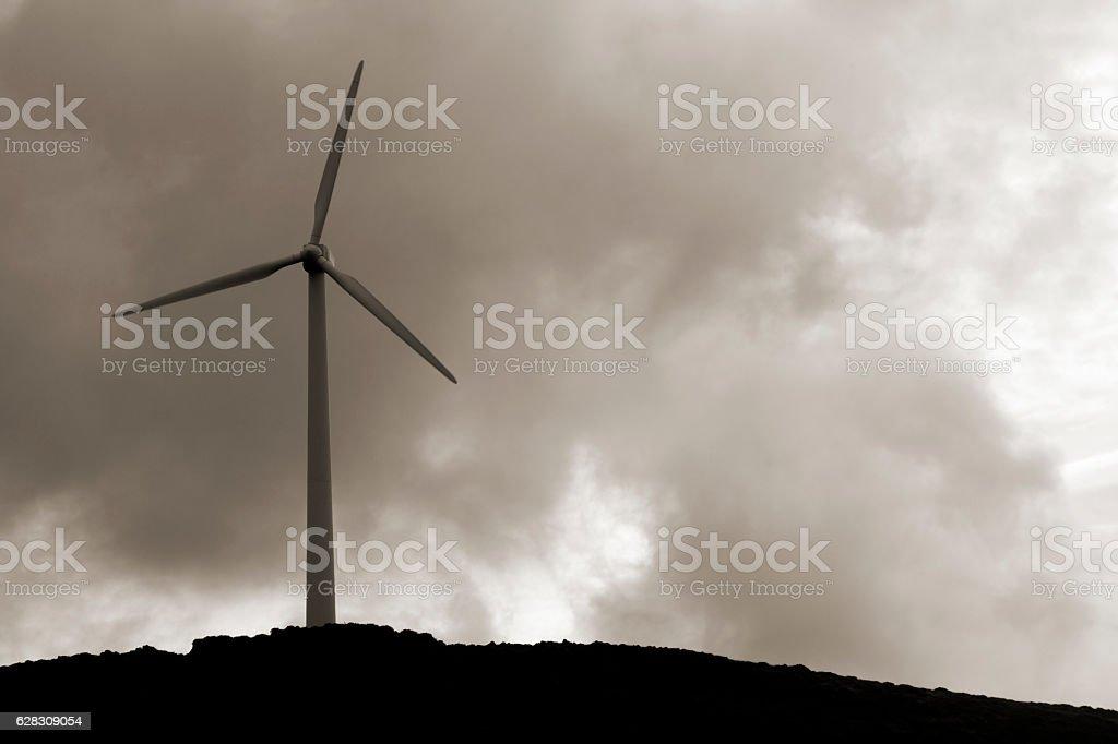 Wind turbine, renewable energy, black and white dramatic sky. stock photo