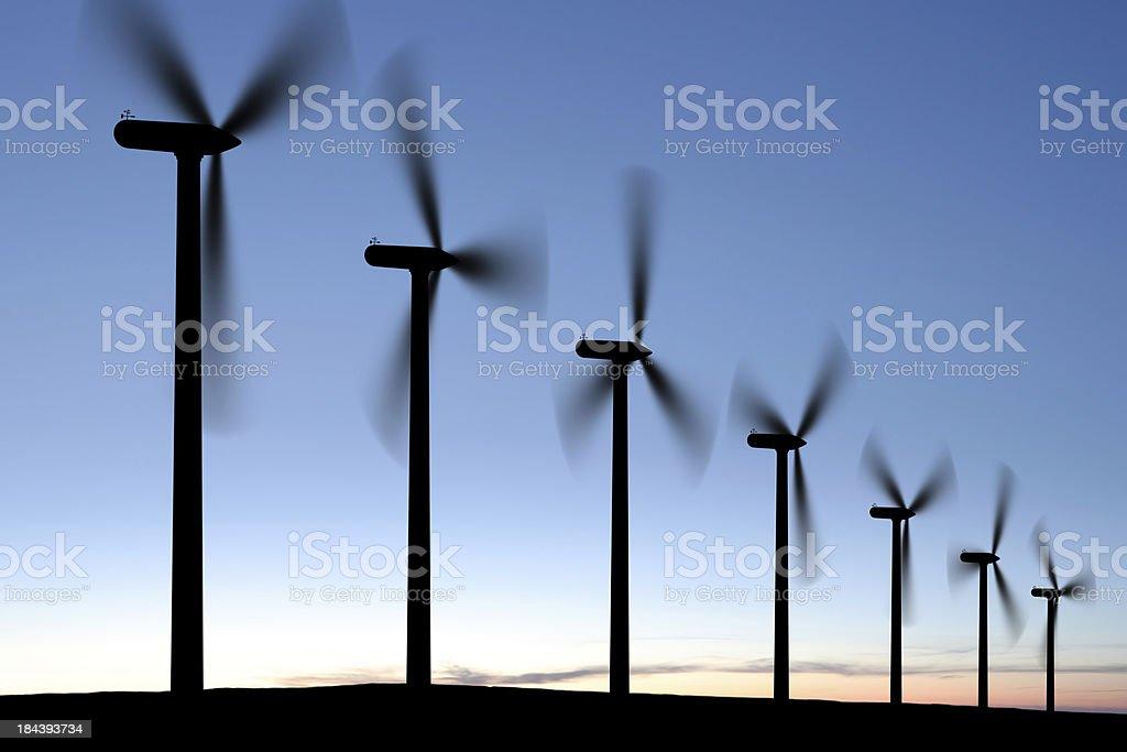 XXXL wind turbine silhouettes royalty-free stock photo