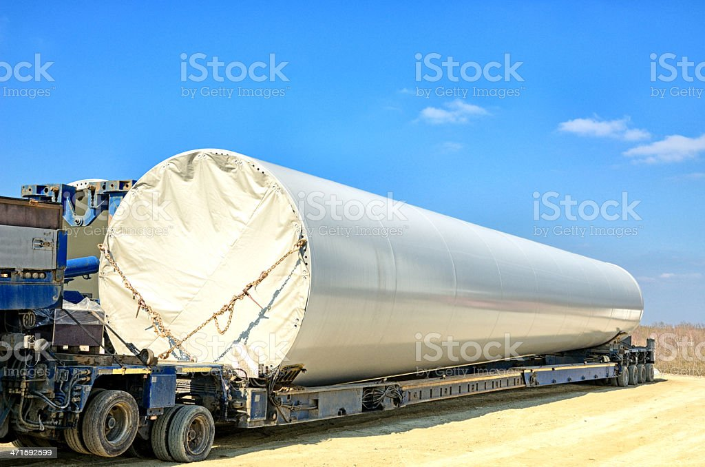 Wind turbine tower segment on low loader royalty-free stock photo