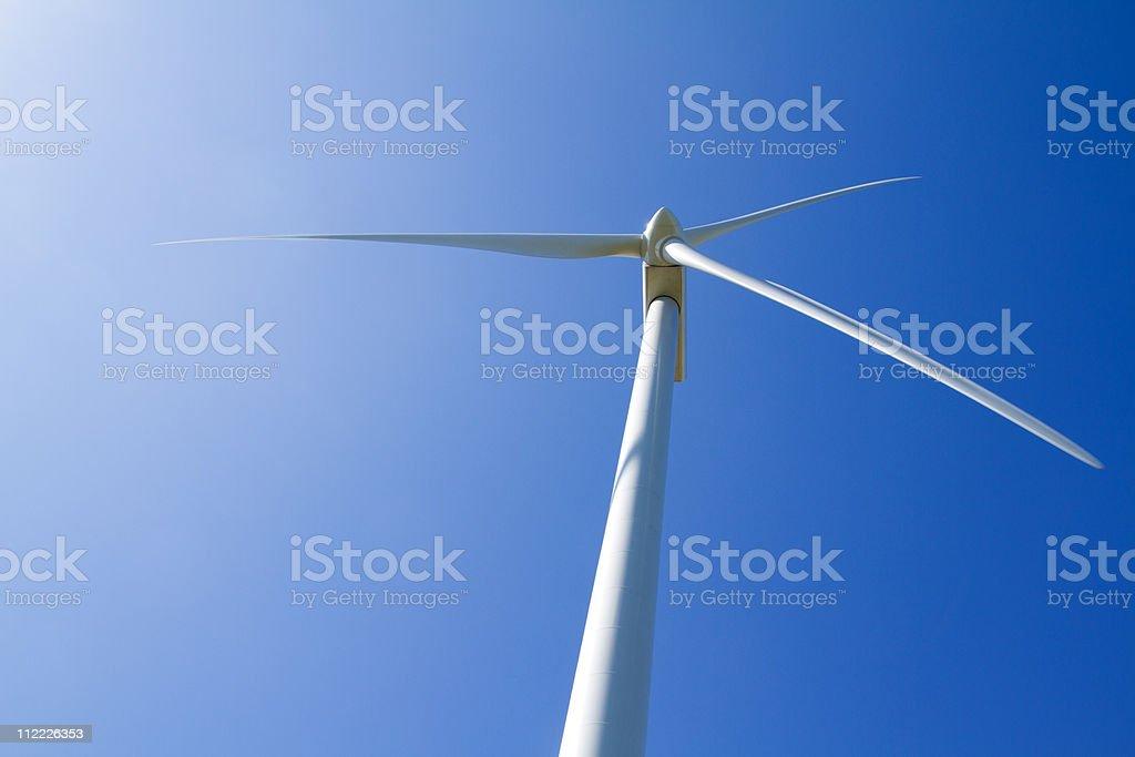 Wind turbine under clear blue sky royalty-free stock photo
