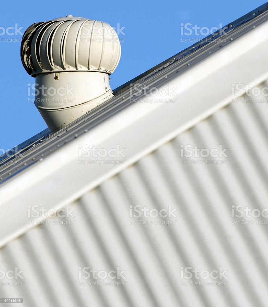 Wind turbine ventilator on corrugated roof stock photo