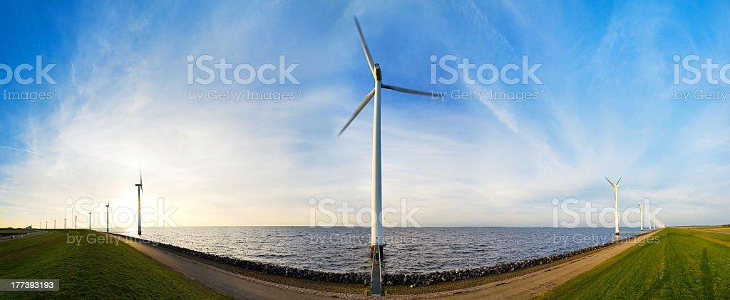 Wind turbine waterside panorama royalty-free stock photo