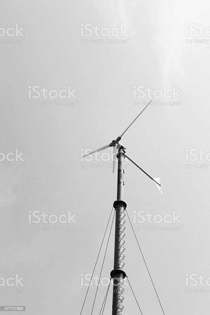 wind turbine with clouds black and white stock photo
