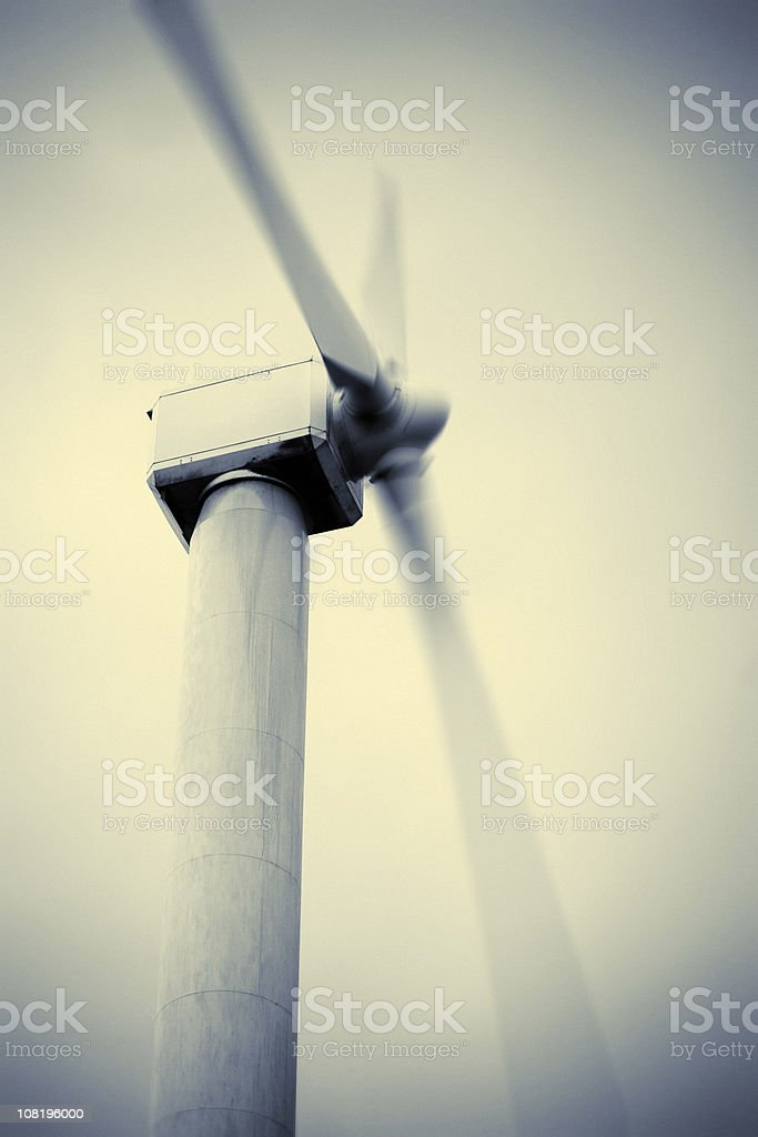 Wind Turbine with Motion Blur of Blades, Toned royalty-free stock photo