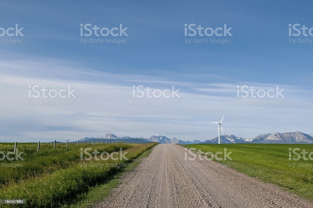 Wind Turbine with mountain view royalty-free stock photo