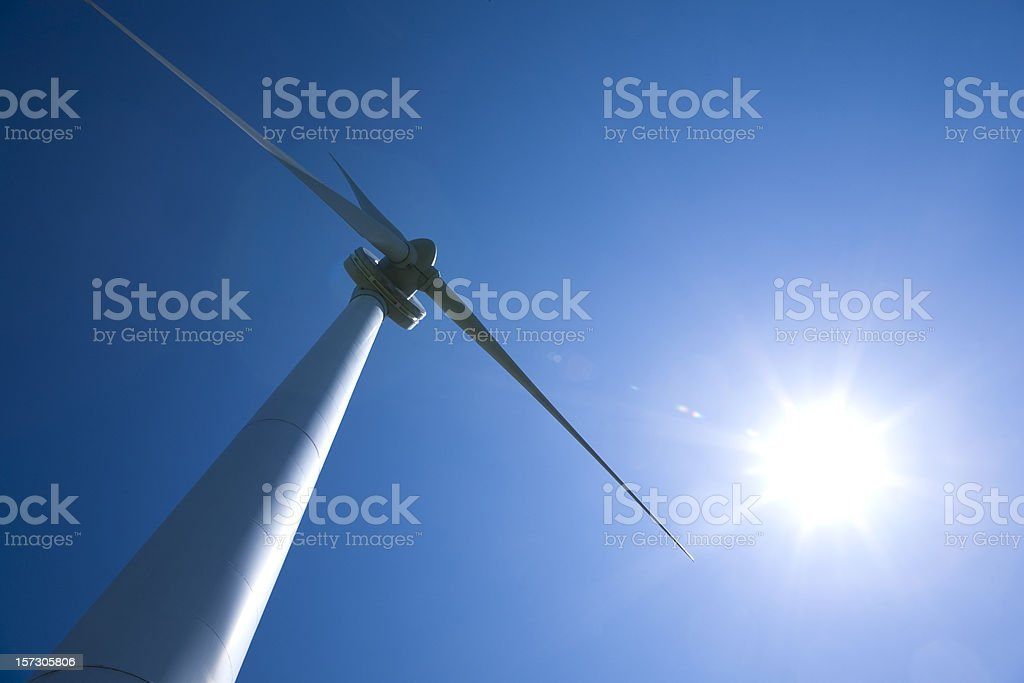 Wind Turbine with the sun behind royalty-free stock photo
