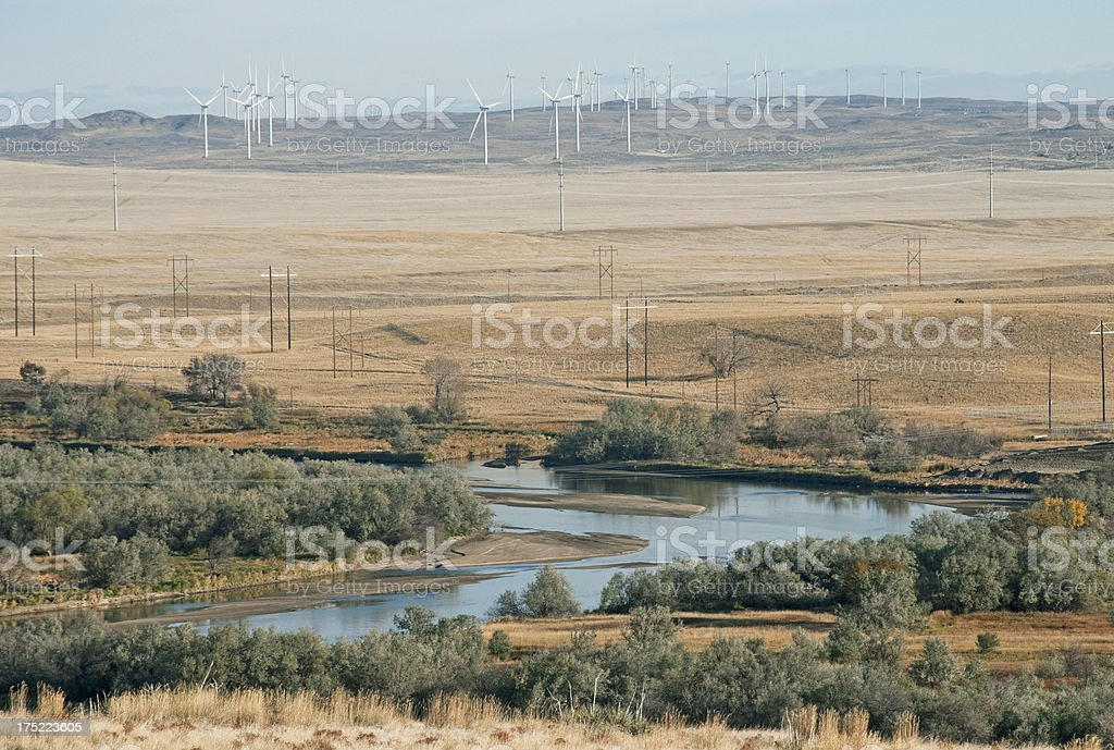 Wind turbines above river in Wyoming stock photo