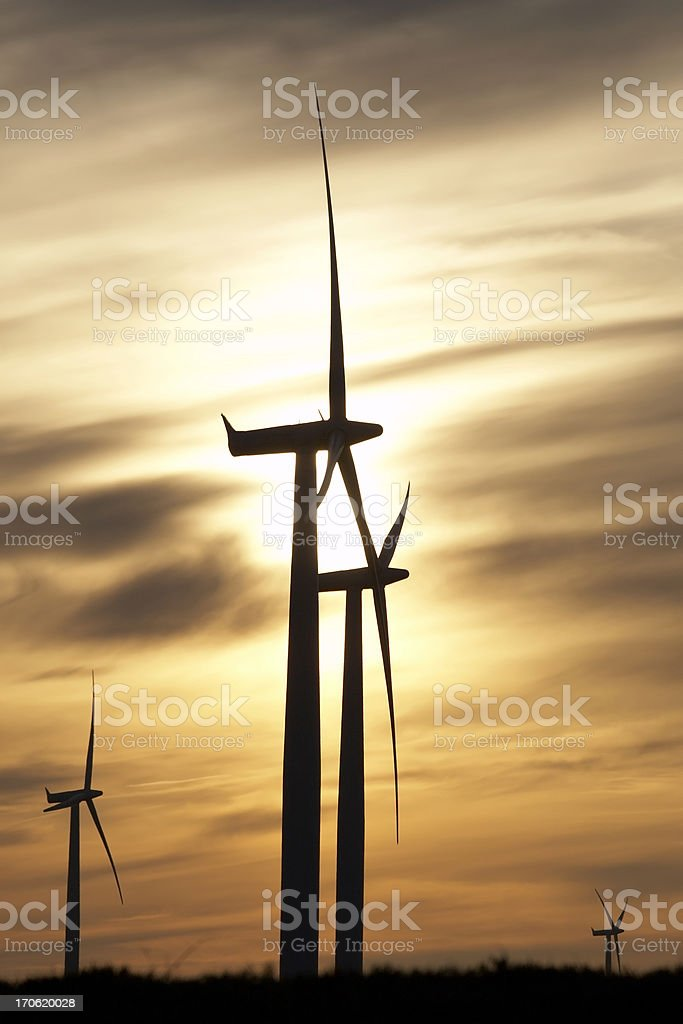 Wind turbines against sunset royalty-free stock photo