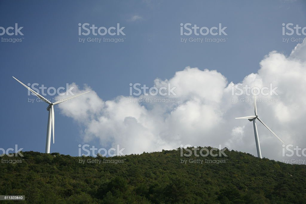 Wind turbines and blue sky with clouds, Turkey stock photo
