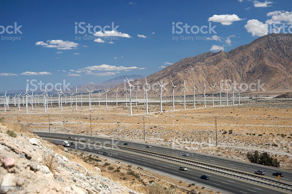 Wind turbines and freeway royalty-free stock photo
