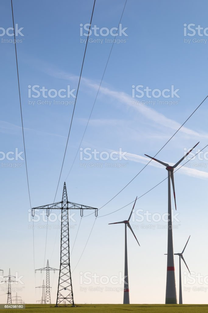 Wind Turbines and High Voltage Transmission Lines in a Huge Wind Farm stock photo