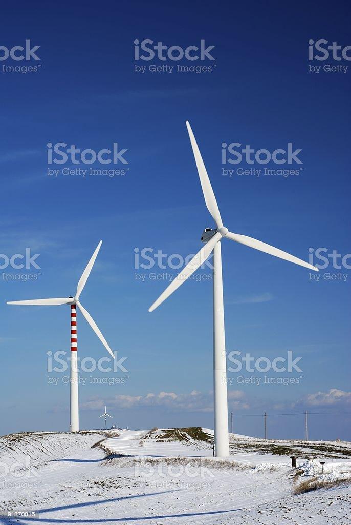Wind turbines and snow stock photo
