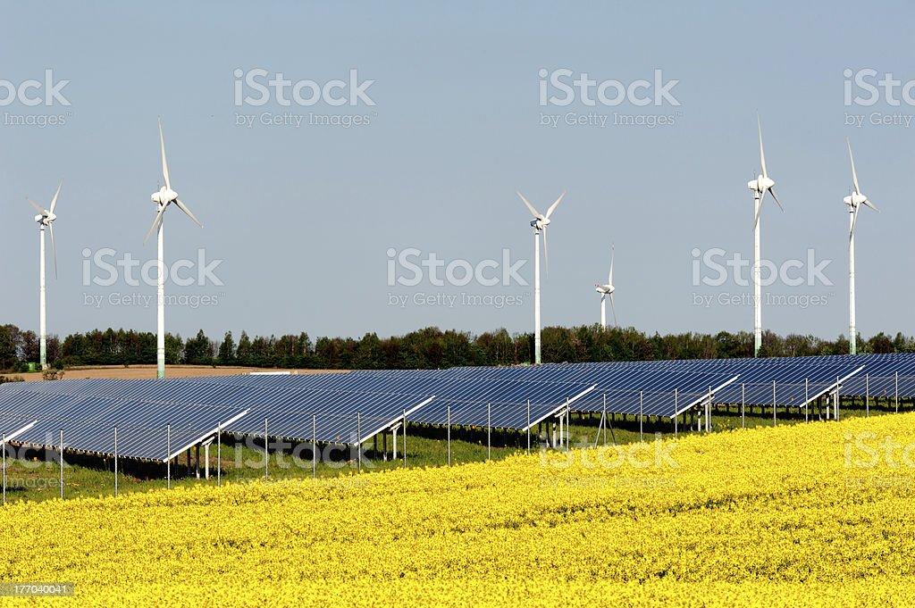 Wind turbines and solar panels stock photo