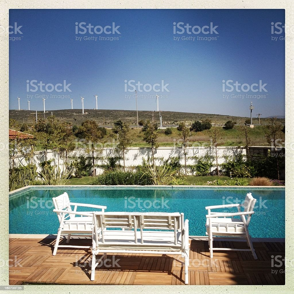 Wind Turbines and swimpool stock photo