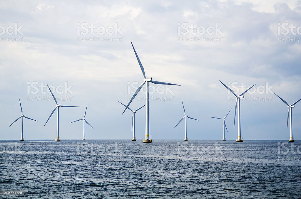 Wind turbines at sea stock photo