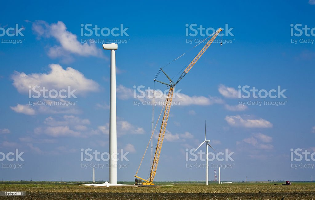 wind turbines being erected royalty-free stock photo