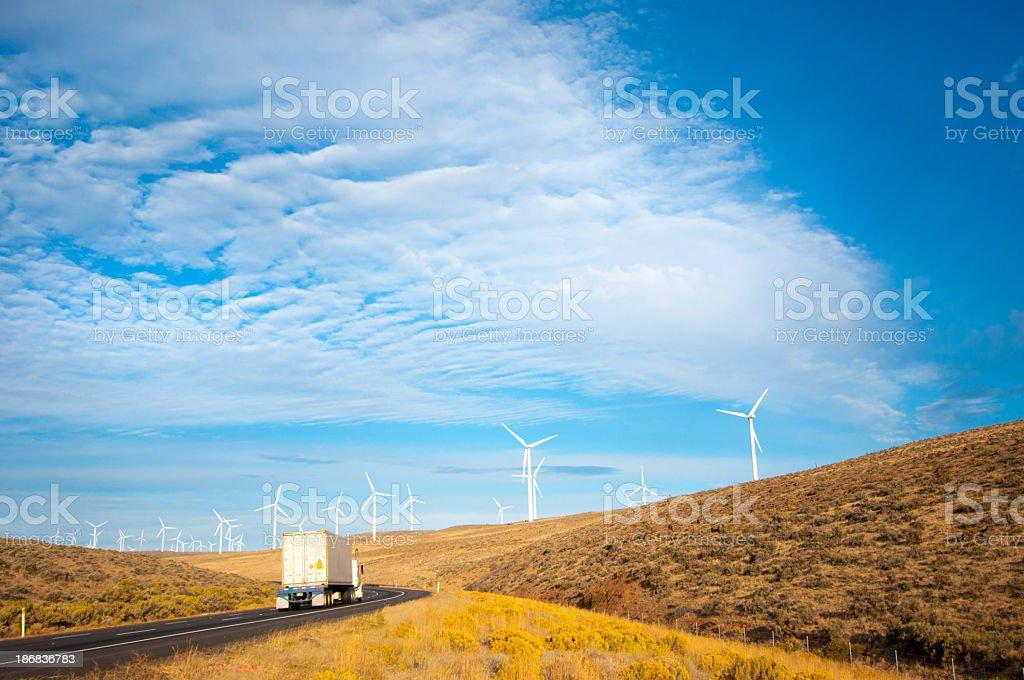 Wind Turbines beside a Highway stock photo