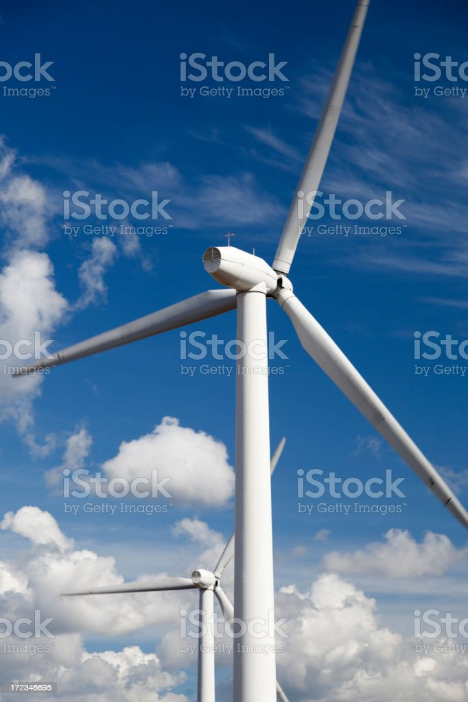 Wind turbines. Blue sky with white clouds. royalty-free stock photo