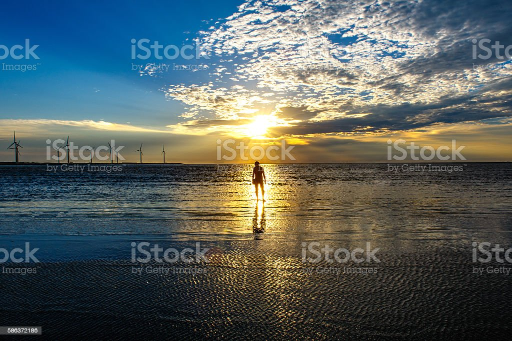 Wind turbines by the sunset stock photo