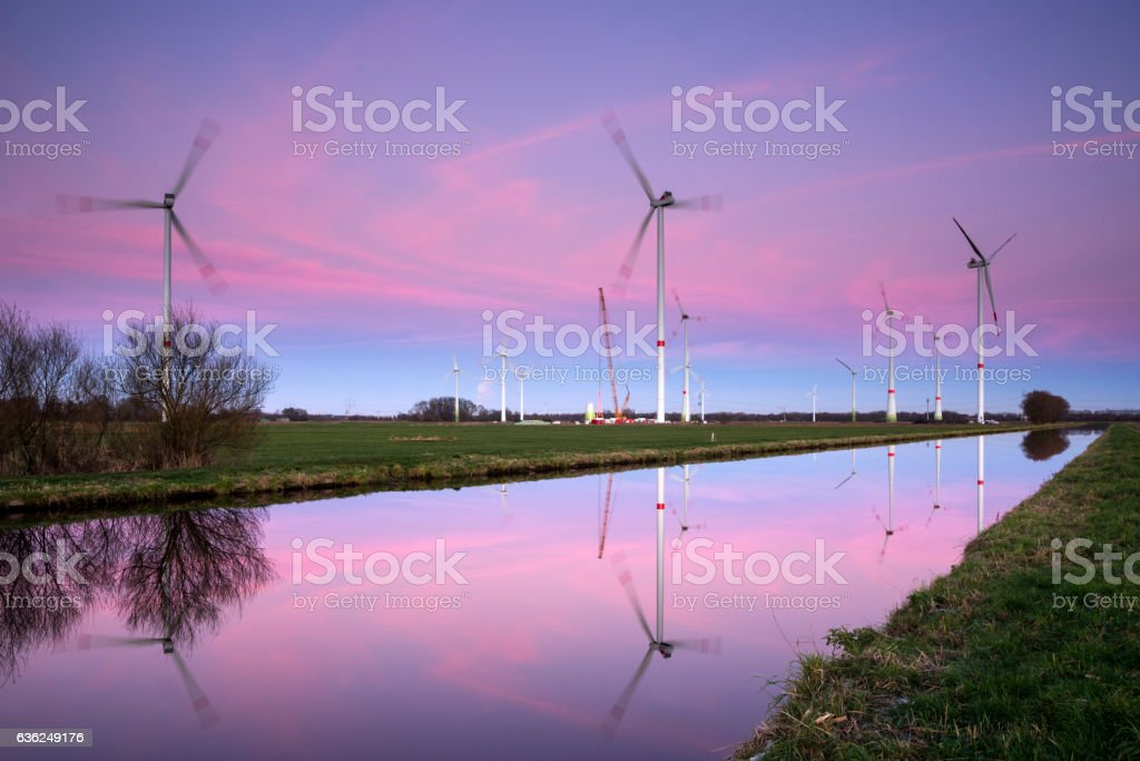 Wind turbines construction site at dusk stock photo