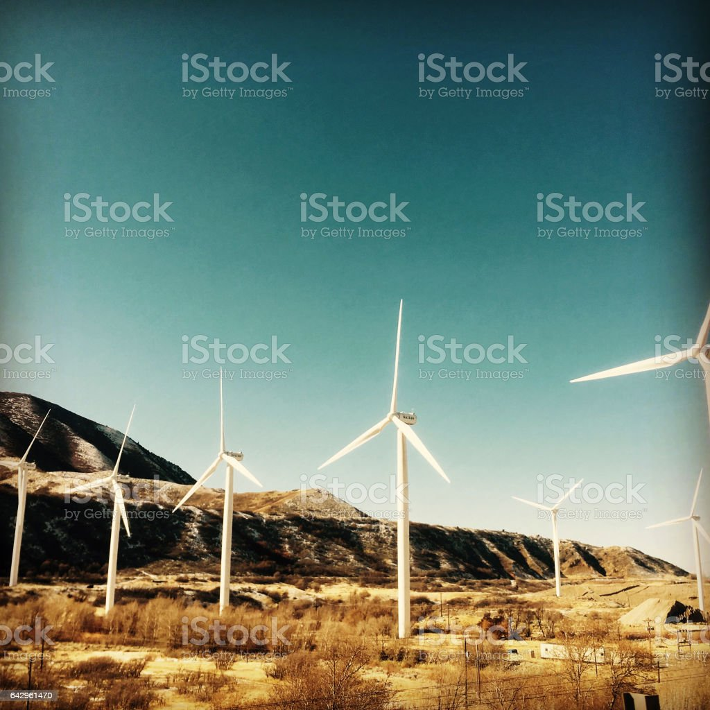 Wind turbines creating clean, renewable energy.  Spanish Fork Canyon, Spanish Fork, Utah. Square crop filtered image. stock photo