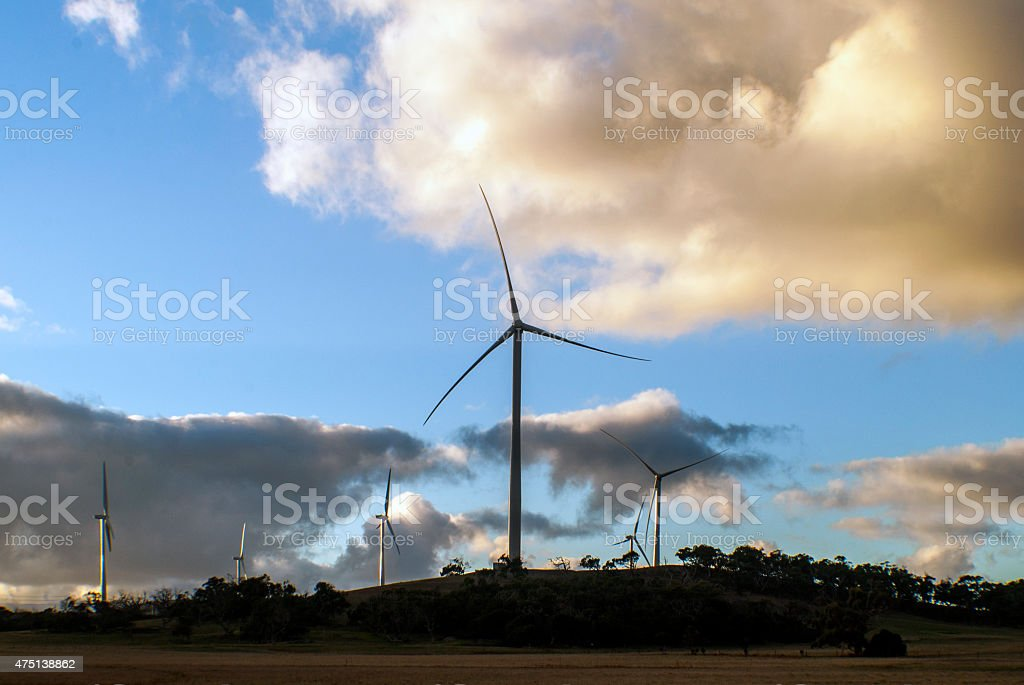 wind turbines in a field on a hill stock photo