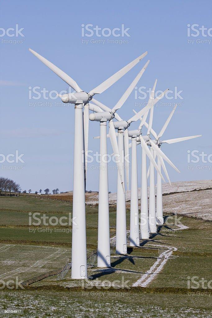 Ветер турбины в очереди на windfarm Стоковые фото Стоковая фотография
