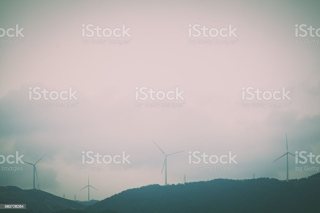 Wind turbines in mountains stock photo