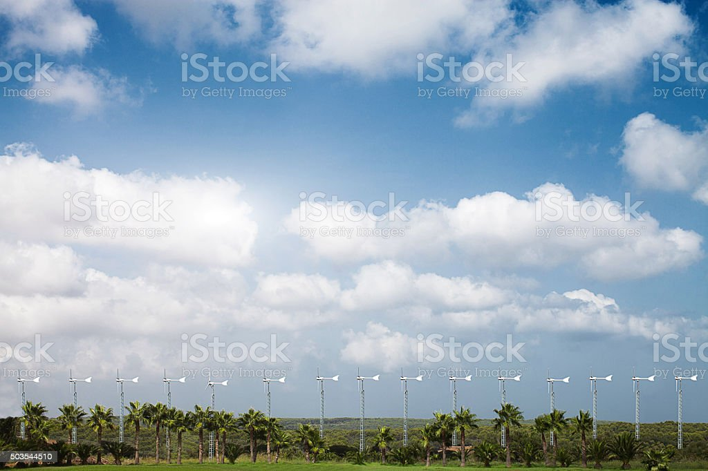 Wind turbines in spanish field during summer stock photo