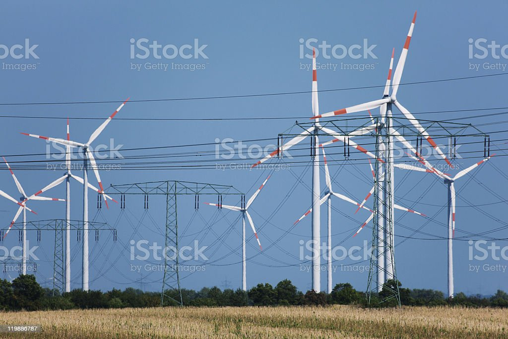 Wind turbines in strong heat haze (!) royalty-free stock photo