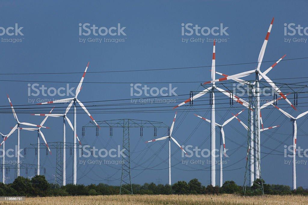 Wind turbines in strong heat haze (!) royalty-free stock photo