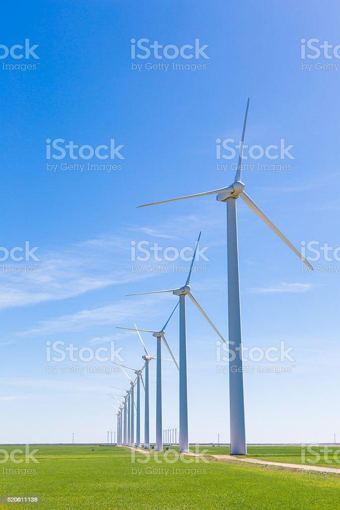 Wind turbines in windmill farm stock photo