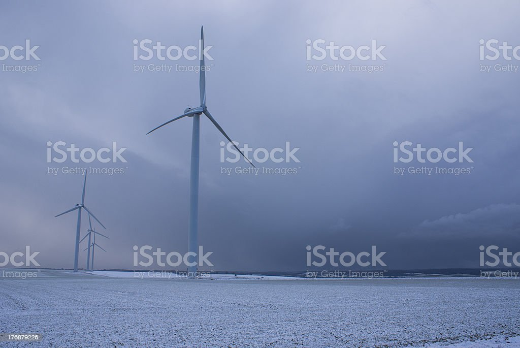 Wind Turbines in winter landscape stock photo