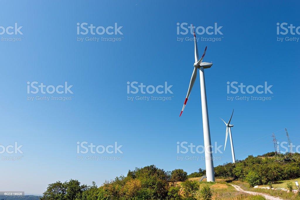Wind Turbines on a Clear Blue Sky - Verona Italy stock photo