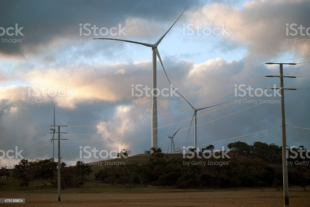 wind turbines on a hill early in the morning stock photo