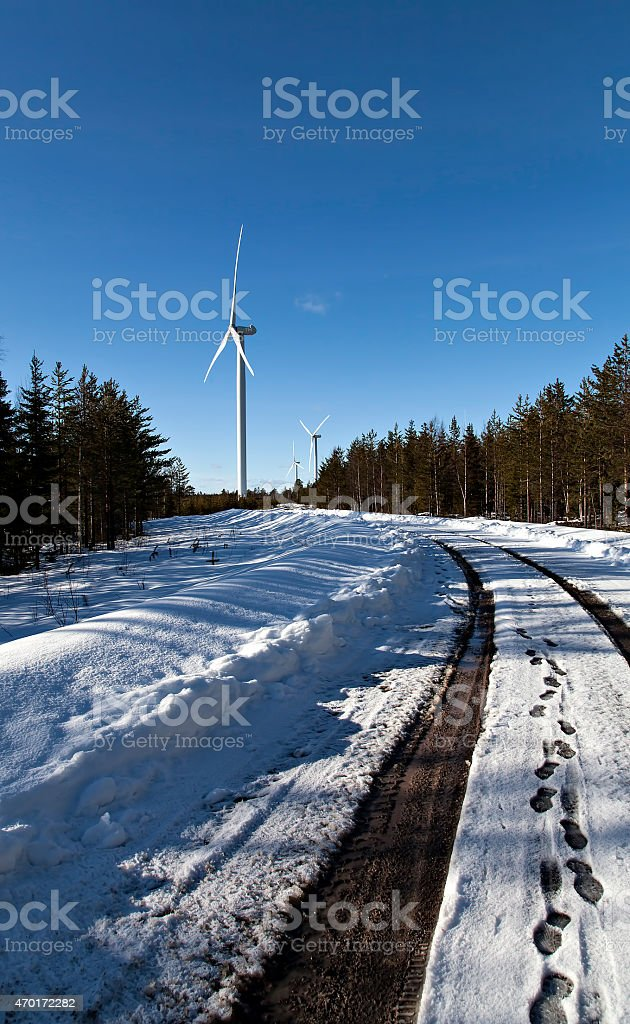 Wind turbines on a road royalty-free stock photo