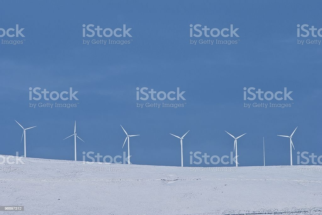 Wind turbines on a snowed mountain royalty-free stock photo