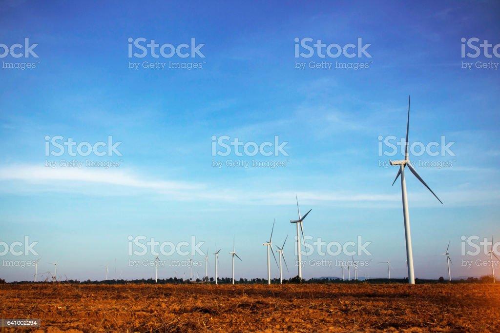 Wind turbines on farm land. stock photo