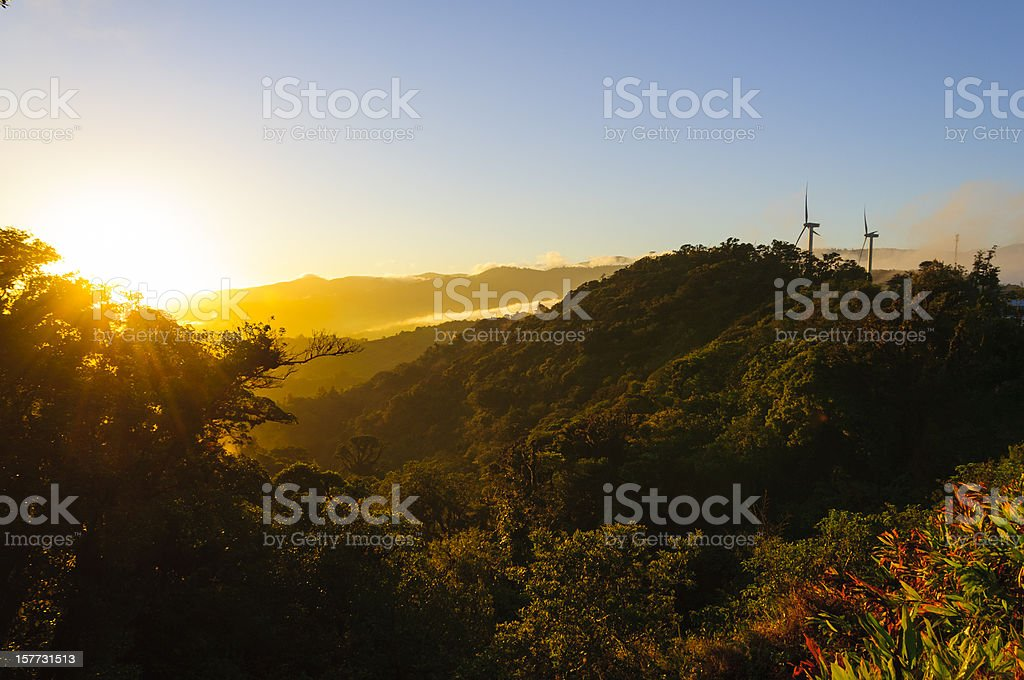 Wind turbines on mountains with early morning sunrise stock photo