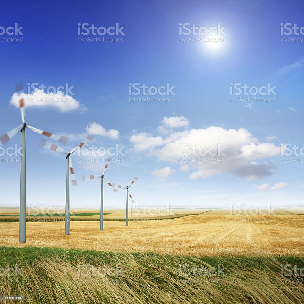 Wind turbines on the field royalty-free stock photo
