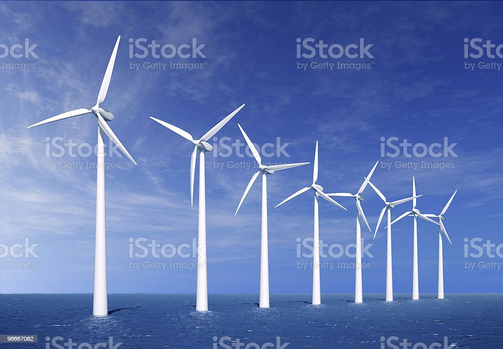 Wind turbines on the sea. stock photo